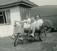 A pedal tricycle outside a holiday cottage/chalet