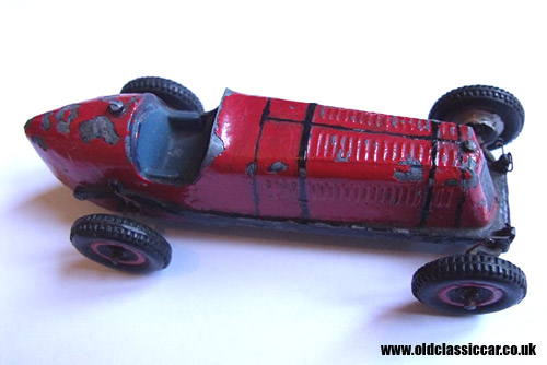 Side view of the Scamold toy racing car