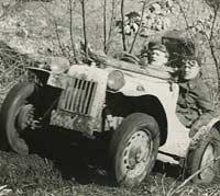 The 1172cc Ford climbs a muddy hill