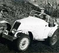 Tackling a muddy trials hill