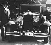 A black and white photo of a pre-war Vauxhall car