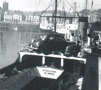 A 1950s Vauxhall being loaded onto a ship