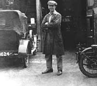 An owner stood outside a vintage car garage