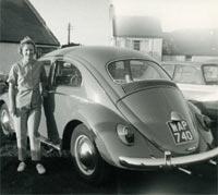 A lady with her VW Beetle