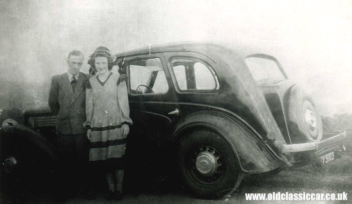 Two people and a Wolseley car
