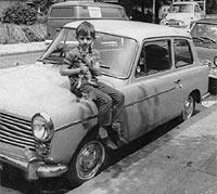 Boy sat on a Mk2 A40 Farina