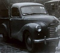 An A40 pickup in a farmyard