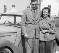 A couple stood with the Austin 8
