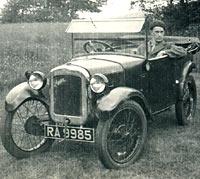 Man sat in a 1929 Austin 7 Chummy