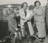 A boy on a bike in the 1930s