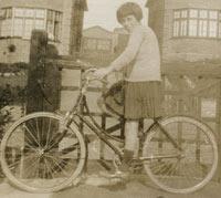 A girl on her 1920s bike