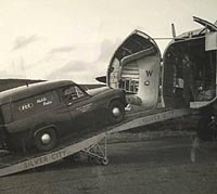 Commer Express delivery van being loaded into the aircraft