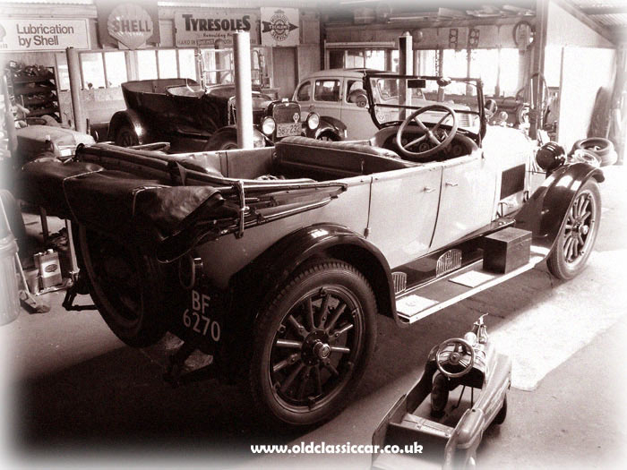 Dodge, Willys-Overland and Hillman Minx in an old garage