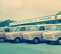A lineup of Mk1 Transit vans
