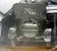 Crushed car in a garage