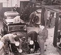 Cars being worked on at Lower Ford St garage