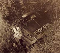 The crashed Minx in a hedge