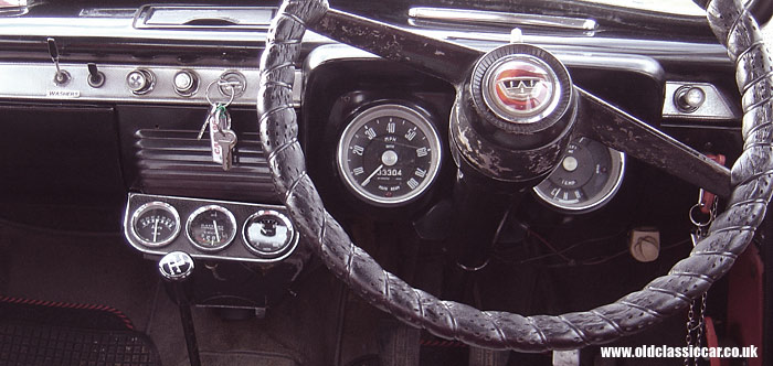 A Ford 107E dashboard fitted with three extra gauges