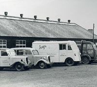 Two Jowett Bradfords and other vehicles