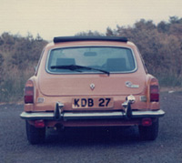Rear view of yellow MGB GT