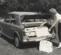 Rear view of a Morris being loaded with bags