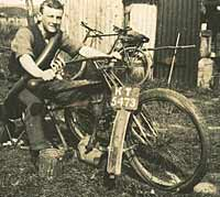 A gent sat on a dismantled motorcycle