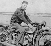 A photo from the 1930s of a motorcyclist and his bike