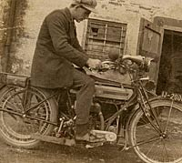 A gent sat on his vintage motorcycle