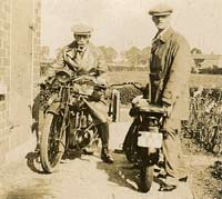 Two vintage motorcycles and riders