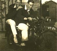 Two riders on a 1926 or 1927 motorbike