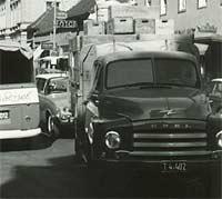 An Opel truck driving along a street