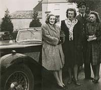 RAF chap with sportscar and two ladies