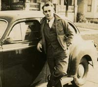 Man with his car in 1942