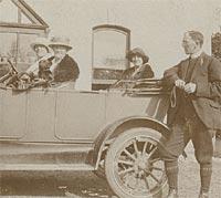 The vicar leans against a 1920s touring car