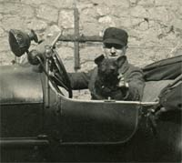 A man, a dog, and a vintage car