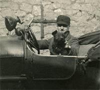 A man, a dog, and a vintage car
