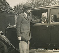 Man, dog and car all together