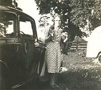 A Morris 8 car in a camping field
