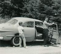 A parked car in the 1950s