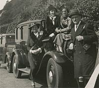 Ladies sat on a car in Bournemouth, 1938