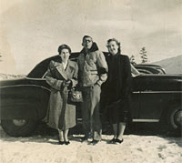 Three people and another Chevrolet