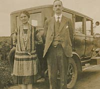 Two people with a vintage car