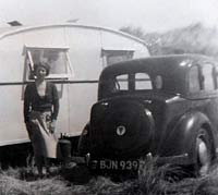 Rover P2 with an old caravan alongside