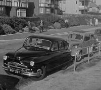 A Phase 1A parked with a Ford Pop, and Morris Oxford