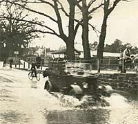A Morris drives through Kenilworth's Ford on Castle Road