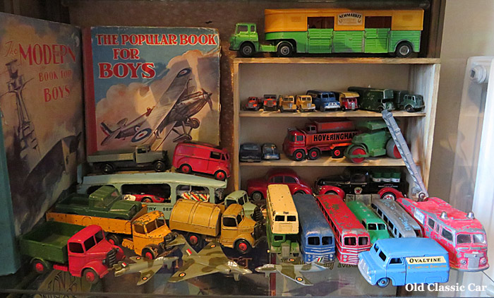 2nd shelf containing toy cars and lorries