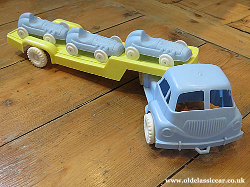 Plastic lorry and racing cars