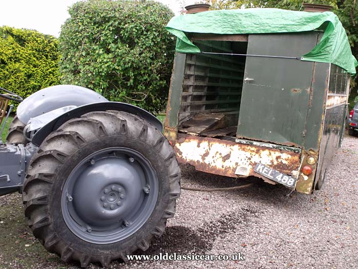 Moving it with the grey Ferguson tractor