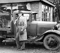 Ford Model AA recovery truck outside the garage