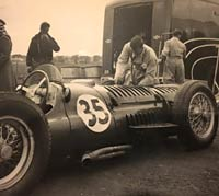 Two BRM V16s and the team transporter